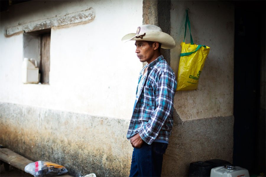 Emiliano waits at home for his day laborers to arrive to harvest his strawberries.