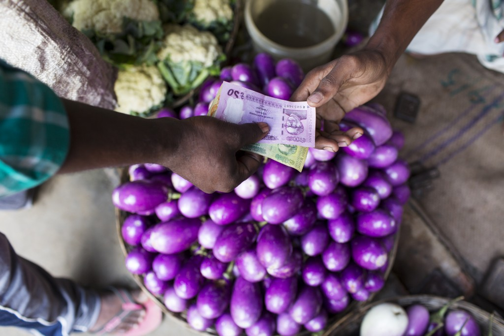 Sohag Mondal buying eggplants at the local market, Mohishaban, Bangladesh