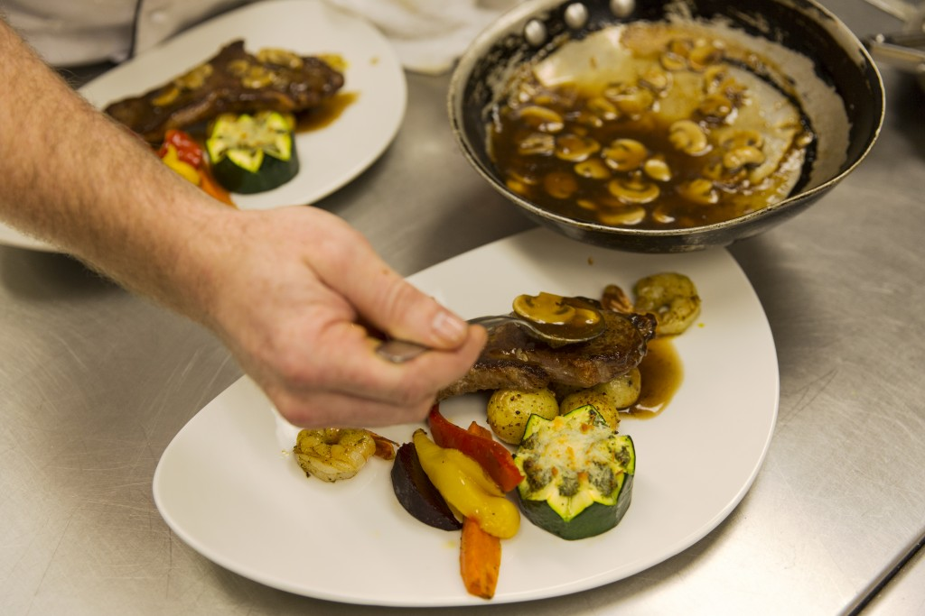Chef Keith White cooks with canola oil in the kitchens at the Boffins Public House, Saskatoon, Canada