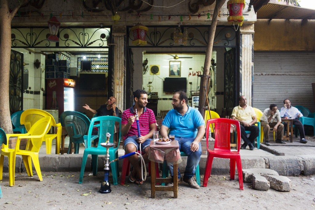 Ahmed Adel Abdel Hameed and Nadeen Mohamed Badawi eat dates, drink coffee and smoke shisha at the terrace of a cafe in Dokki, Cairo, Egypt.