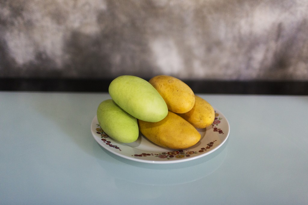 Mangoes on the kitchen table of Yolanda Alcantara, Batangas City, Philippines.