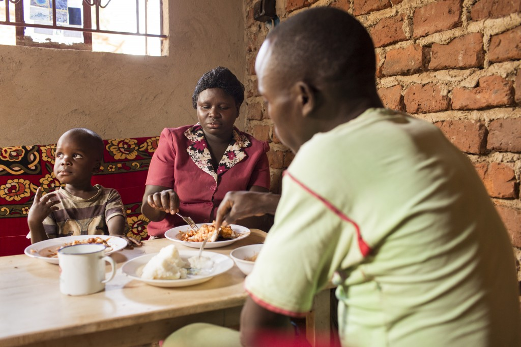 Agnes Makilumda, with husband Makesa Lozio and son Nyombi Temdo, eating Ugali, Namulonge