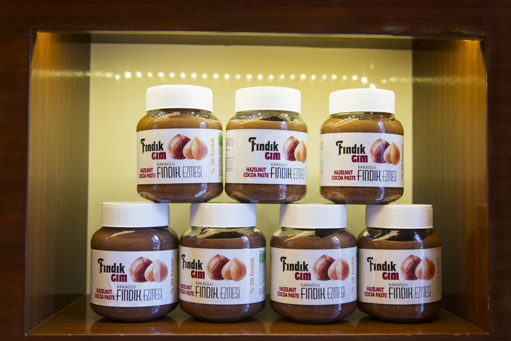 Jars of hazelnut paste on a shelf at the Findik Evi Black Sea Chocolate Shop, Giresun, Turkey.